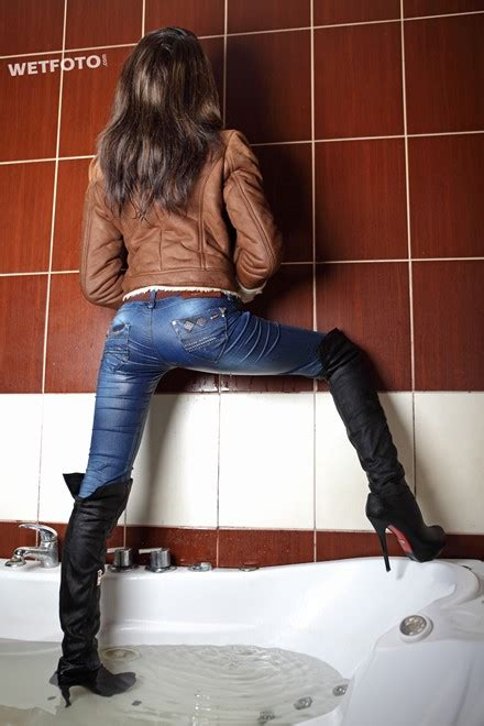 Wetlook by Brunette Girl in Wet Jacket, Tight Jeans and