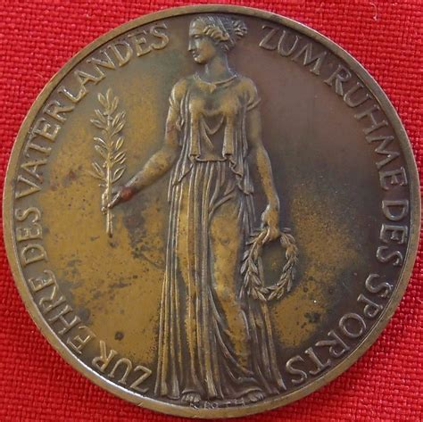 **SOLD** OFFICIAL VISITORS MEDAL FOR THE GERMAN 1936
