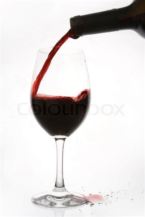 Red wine being poured into a wine glass too fast | Stock