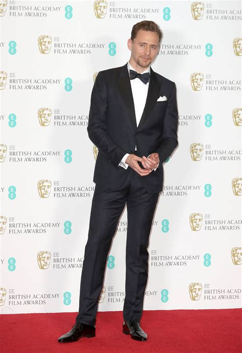 TryHard Tom Hiddleston at the BAFTAs with Noomi Rapace