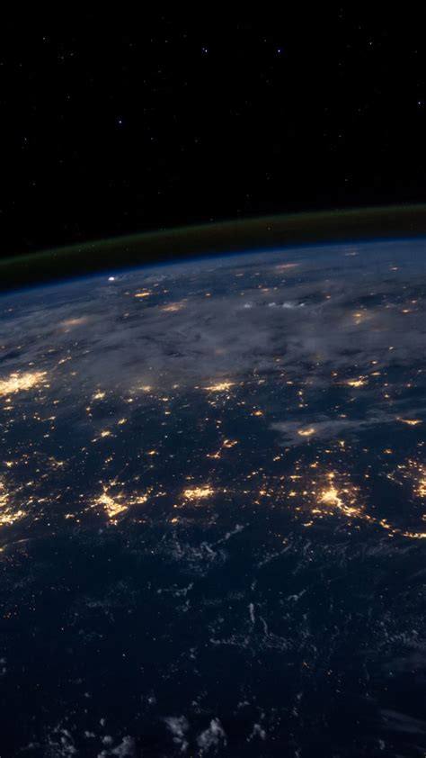 View Of Earth From Space At Night 4K UHD Wallpaper