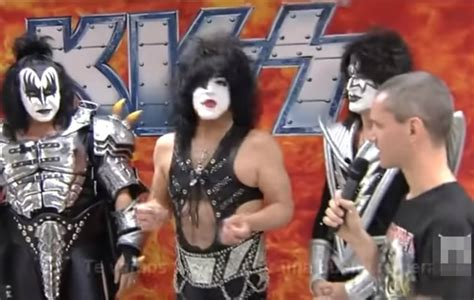 Watch KISS force an interviewer to take off his Iron